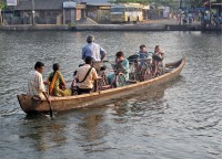 The bikes are transported with boat over backwaters